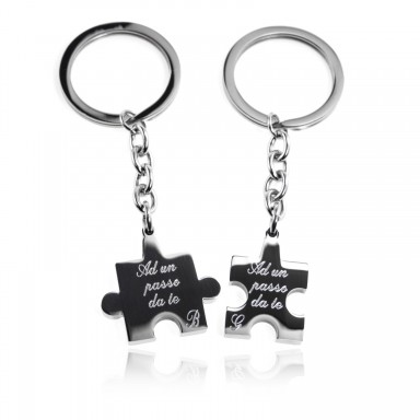 Pair of stainless steel puzzle keychains