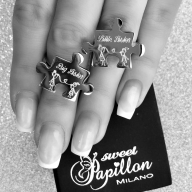 Pair of stainless steel puzzle sister rings
