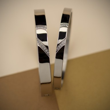 Pair of rigid bracelets for lovers in stainless steel