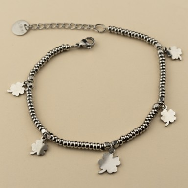 Bracelet with nuggets and four-leaf clovers in stainless steel
