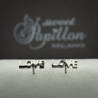 Pair of LOVE micro earrings in stainless steel