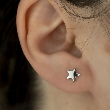 Single micro star earring in 925 silver