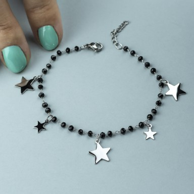 Bracelet with black crystals and hanging stars in stainless steel